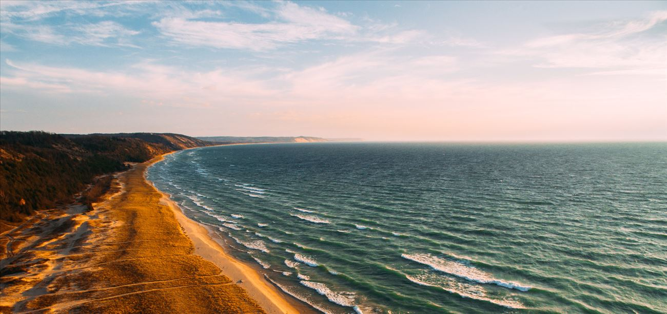 Aerial view of Lake Michigan shoreline with beach and waves